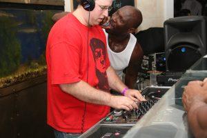 MC enthusiastically rocking alongside DJ Herbert Holler!